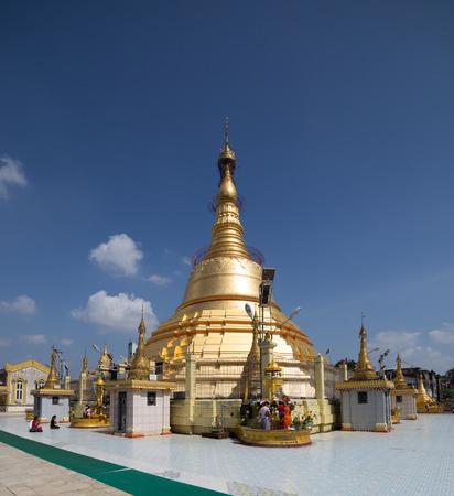 pilgrimage: YANGON, MYANMAR - NOVEMBER 22, 2014: many unidentified people are on a pilgrimage to Botataung Pagoda in Yangon, Myanmar.