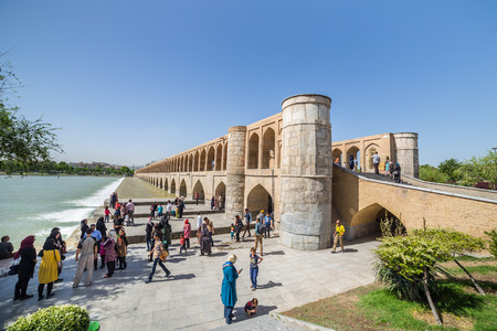 iran: ISFAHAN IRAN APRIL 28 2015: unidentified people resting in the ancient bridge SioSeh Pol The Bridge of 33 Arches in Isfahan Iran