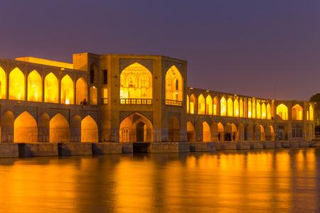 isfahan: ISFAHAN IRAN APRIL 28 2015: unidentified people resting in the ancient Khaju Khaju Pole Bridge in Isfahan Iran Editorial