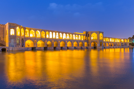 ISFAHAN IRAN APRIL 28 2015: unidentified people resting in the ancient Khaju Khaju Pole Bridge in Isfahan Iran Editorial