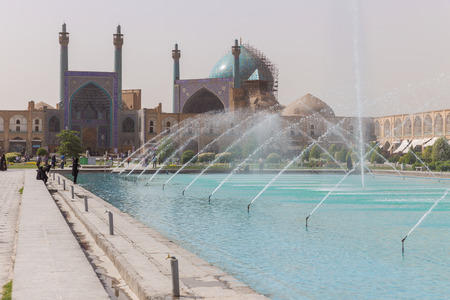 shah: ISFAHAN, IRAN - APRIL 29, 2015: Imam Mosque (Masjed-e Imam) at Naghsh-e Jahan Square in Isfahan, Iran. Imam mosque is known as Shah Mosque. Its construction finished in 1629. Editorial