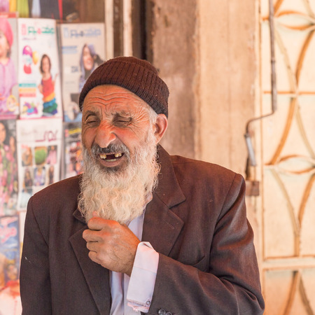 shiraz: SHIRAZ, IRAN - APRIL 26, 2015: unidentified old man at the street market in Shiraz, Iran