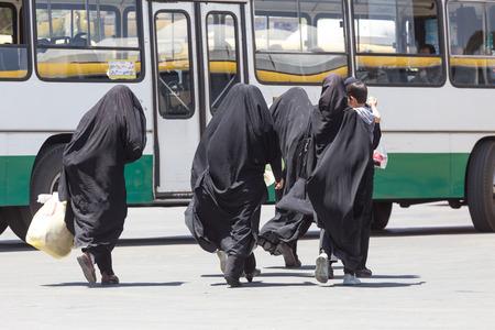 burqa: SHIRAZ, IRAN - APRIL 26, 2015: unidentified women walking in Shiraz, Iran