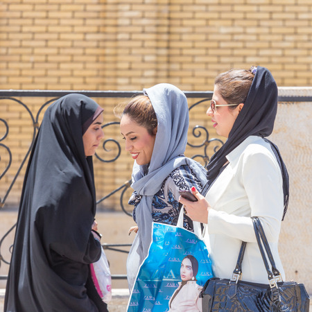 burqa: SHIRAZ, IRAN - APRIL 26, 2015: unidentified women walking in Shiraz, Iran