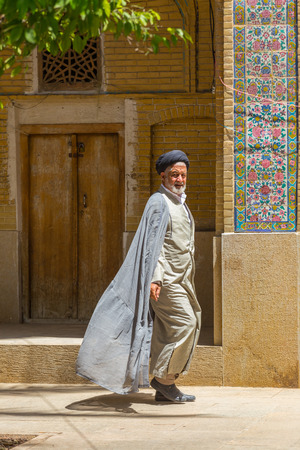 shiraz: SHIRAZ, IRAN - APRIL 26, 2015: religious unidentified man in Shiraz, Iran