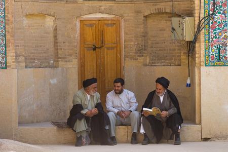 iran: SHIRAZ, IRAN - APRIL 26, 2015: religious unidentified men in Shiraz, Iran