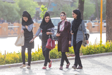 veils: SHIRAZ, IRAN - APRIL 25, 2015: unidentified women walking in Shiraz, Iran