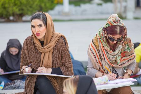 isfahan: Women who paint in Naqsh-e Jahan Square in Isfahan, Iran.