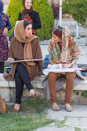 safavid: Women who paint in Naqsh-e Jahan Square in Isfahan, Iran.