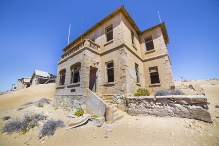 luderitz: Abandoned houses in the ghost town of Kolmanskop, near Luderitz, Namibia