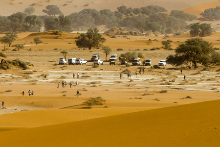 View of the parking in the red dunes of  the Namib Desert, in the Namib-Naukluft National Park of Namibia, Sossusvlei