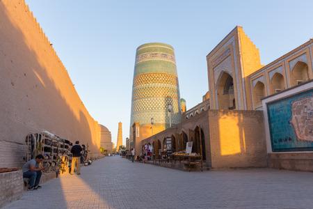 minor: KHIVA, UZBEKISTAN - AUGUST 24, 2016: unidentified people in front of the Kalta Minor Minaret, Khiva Landmark, in Uzbekistan
