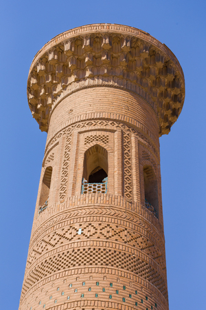 Sayid Niaz Sheliker Minaret, close to the East Gate of Khiva, in Uzbekistan.