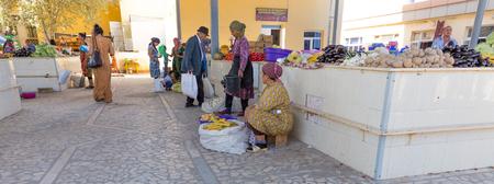 csi: KHIVA, UZBEKISTAN - AUGUST 25, 2016: unidentified people make food shopping at the fruit and vegetable market close the East Gate of Khiva, in Uzbekistan.