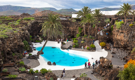 manrique: LANZAROTE, SPAIN - NOVEMBER 29, 2016: people at the Jameos del Agua, part of a 6Km long lava tube which formed about 4,000 years ago when the Montana La Corona erupted. The tourist attraction was conceived by Cesar Manrique, during the 1960s in Lanzarote Editorial