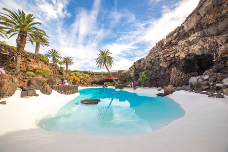 LANZAROTE, SPAIN - NOVEMBER 29, 2016: people at the Jameos del Agua, part of a 6Km long lava tube which formed about 4,000 years ago when the Montana La Corona erupted. The tourist attraction was conceived by Cesar Manrique, during the 1960s in Lanzarote Editorial