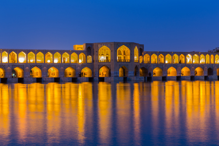 ISFAHAN, IRAN - APRIL 28, 2015: unidentified people resting in the ancient Khaju Bridge, (Pol-e Khaju), in Isfahan, Iran