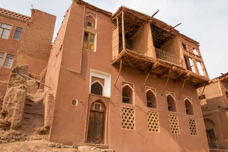 The tipical red mud-brick houses in the ancient village of Abyaneh, near Kashan, in Iran Stock Photo