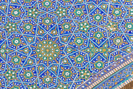 Detail of tile work in Mir-i-Arab Madrasah in Bukhara (Bukhara), Central ASIAA ¢ à ¢, ˆ ¢ ¢ s holiest city in Uzbekistan. Ità ¢ à ¢, ˆ ¢ ¢ s among Uzbekistana ¢ à ¢, ˆ ¢ ¢ s most striking medressas. Stock Photo