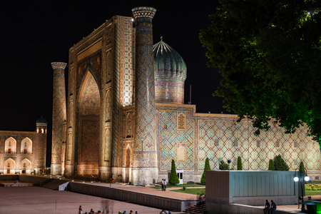 SAMARKAND, UZBEKISTAN - AUGUST 28, 2016: View of Sher-Dor Madrasah at night, in Samarkand, Uzbekistan