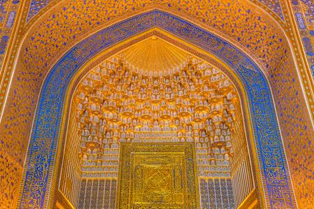 registan: SAMARKAND, UZBEKISTAN - AUGUST 28, 2016:  Detail of gold mosaic in Tilya Kori Madrasah in Samarkand, Uzbekistan