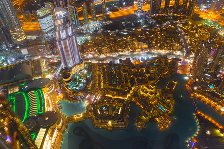 Dubai downtown night scene with city lights from the top of Burj Khalifa