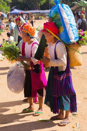 INLE LAKE, MYANMAR - NOVEMBER 30, 2014: people at Inn Dain Khone village, in Inle lake, Myanmar