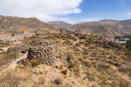 View of pre-Inca ruins and Chivay town in Peru. These ruins were used for food storage or burials.
