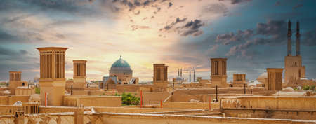 Panoramic view of badgirs and mosques of Yazd on a cloudy day, in Iran