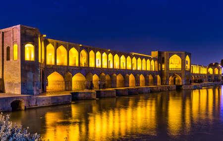 unidentified people resting in the ancient Khaju Bridge, (Pol-e Khaju), in Isfahan, Iran