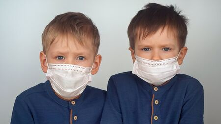 Kids with protection face mask. Virus protection, respiratory disease, contamination, inhaling toxic