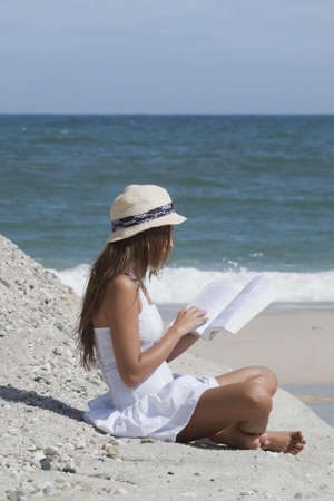 woman reading: woman  relaxing on the beach reading