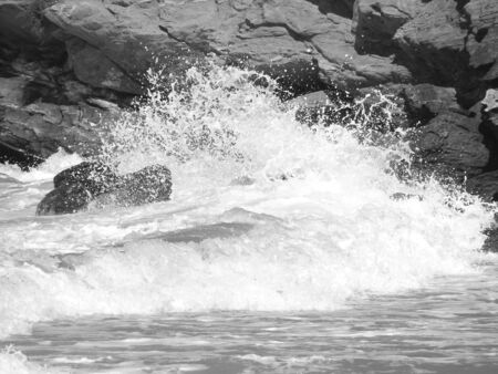 Waves smashing on rocks and beach Stock Photo - 4124299