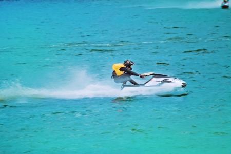 Jetski racing on a blue water background photo