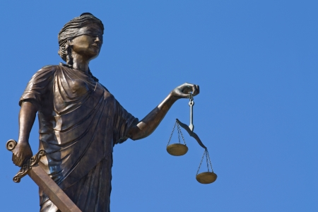 justice scales: Justice statue with scales and sword Stock Photo