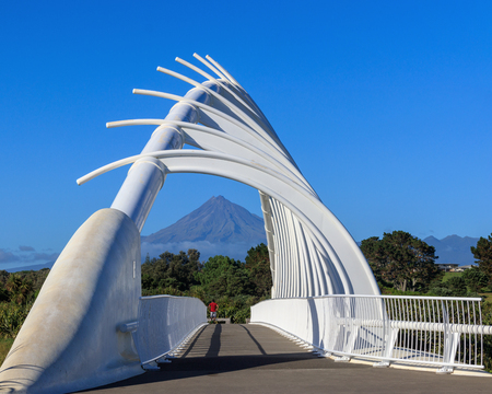 Mt Taranaki volcano and bridge perspective Stock Photo