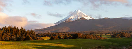 Picturesque rural landscape with mount Taranaki snow top, New Zealand