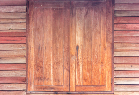 large doors: The old  wooden walls and large doors.