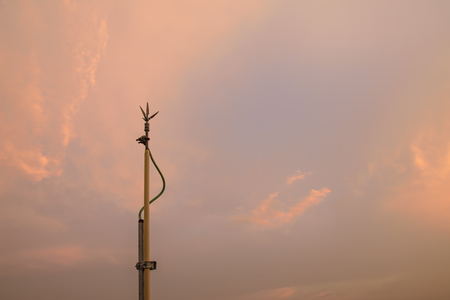 Lightning rods, lightning protection on sun set.