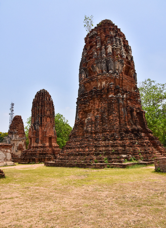 asian art: Ruins of stupa and statue of Buddha in Wat Mahathat, the ancient Thai temple in Ayutthaya Historical Park. Was built in 1374