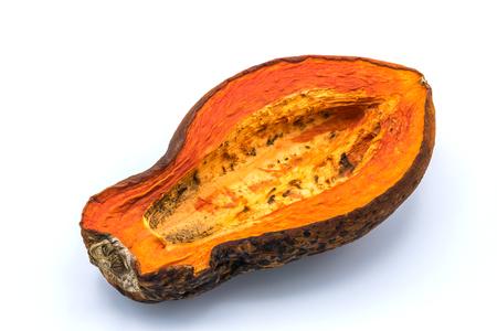 penicillium: Papaya is ripe yellow-orange. It was kept so rotten and moldy on isolated white background.