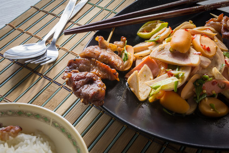 delicious spicy thai food of mix salad and hot dog Fried pork in back dish. Stock Photo