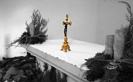the altar: Golden cross in a chapel