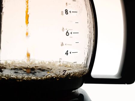 percolator: Coffee dripping into jug from coffee percolator Stock Photo
