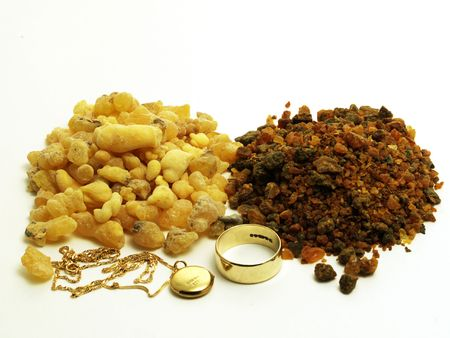 frankincense: Piles of frankincense and myrrh with gold jewellery isolated on white Stock Photo