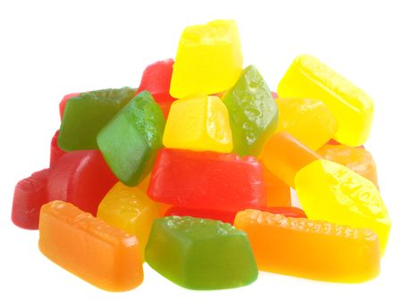 Pile of brightly coloured wine gums isolated on white