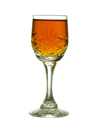 Backlit sherry in cut crystal glass, backlit and  isolated on white         photo