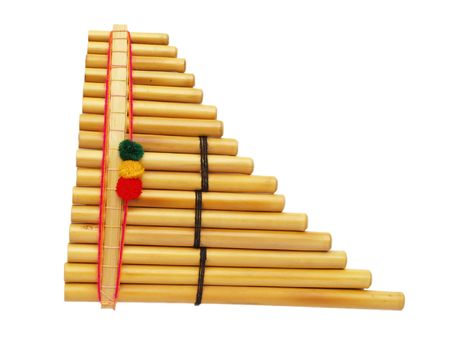 panpipe: Set of bamboo pan pipes with woolen decorations, isolated on white