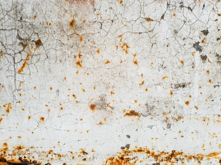 Texture of white paint with cracks and rust on metal surface, background