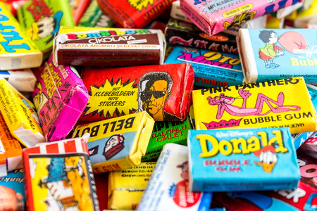 eighties: ASHDOD, ISRAEL - SEPTEMBER 27, 2015: Many various colorful chewing or bubble gum from seventies, eighties and nineties, including Robocop, Turbo, Donald Duck, BomBibom, TipiTip, X-Men, Dunkin, OtoMoto